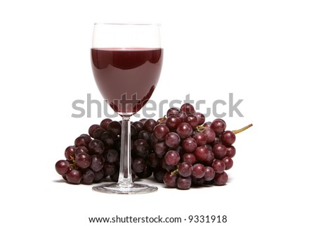 Red grapes and a glass of red wine - stock photo