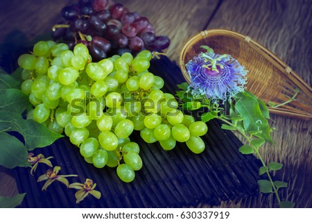 Red grapes and green grapes in bamboo sticks on old wooden floor felling low light mood & Red Grapes Green Grapes Bamboo Sticks Stock Photo 630337904 ... azcodes.com