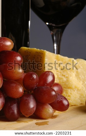 red grapes and sharp cheese