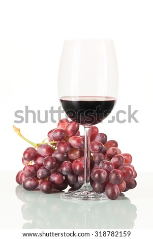 Red grapes and wine in glass