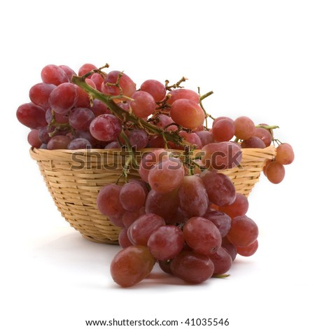 Red Grapes - High resolution image of red grapes in a basket. Subject isolated on white background. - stock photo
