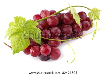 Red grapes with fresh leaves, isolated on white background - stock photo