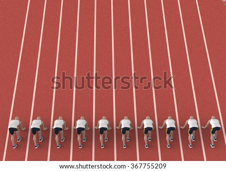 red gravel running track with athletes in start position. - stock photo