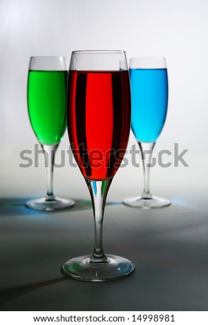 red green and blue colored cocktail over white