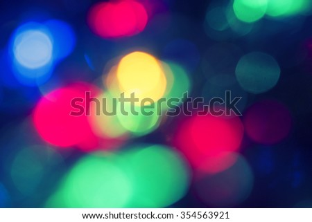Red, green and blue defocused lights background. Christmas holiday wallpaper. - stock photo
