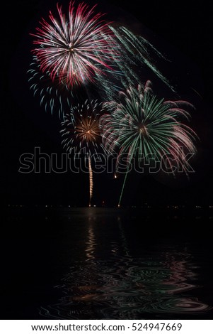 Red, Green and blue  Fireworks with lake reflection