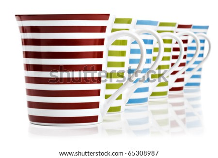 Red, green and blue mugs on a white background with space for text - stock photo