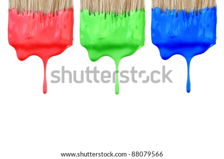Red, green and blue paint dropping from brush isolated on white background. Graphic design creativity concept. - stock photo