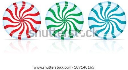 Red, Green, and Blue Peppermint Candy with a Shadow and Reflection - stock photo