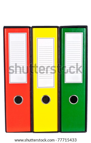 Red, green and yellow office folders with boxes isolated on white background - stock photo