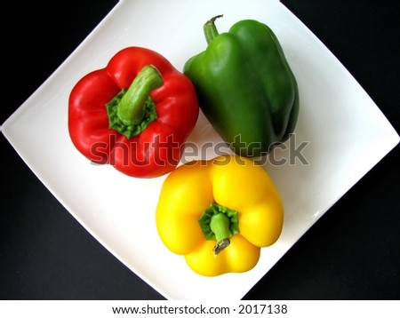 Red Green and Yellow Peppers - stock photo