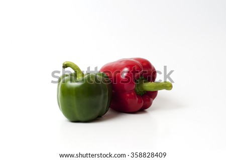 red green bell peppers (capsicum) on a white isolated  background - stock photo