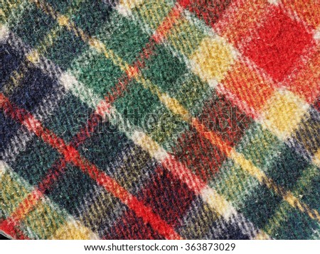 Red green blue and yellow tartan fabric useful as a background - stock photo