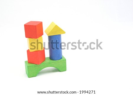Red, green, blue and yellow wooden play blocks