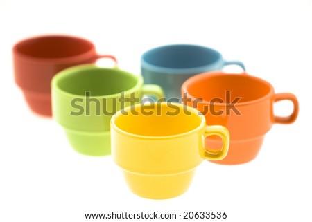 Red, green, blue, yellow and orange mugs - stock photo