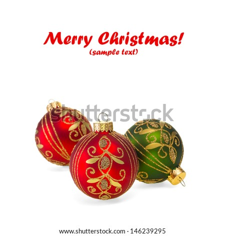 Red & green Christmas balls on white with copy space. - stock photo