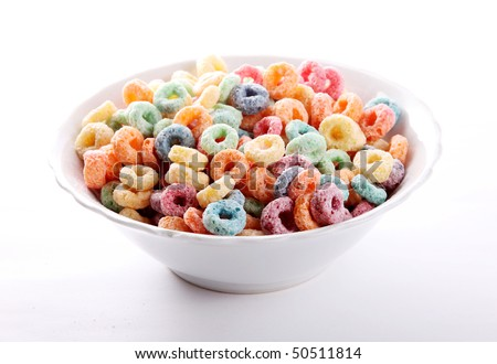 Red, green, yellow and orange cereal fruit on white dish - stock photo