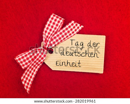 red greeting card background with cute bow - german for german unity day - stock photo