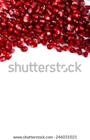 Red grenadine seeds on the upper side on white  - stock photo