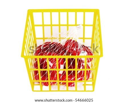 Red groceries in yellow basket - stock photo