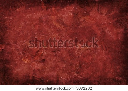 Red grunge background with leaves. - stock photo