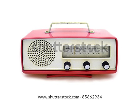 Red grungy retro radio on  isolated white background - stock photo