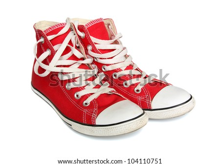 Red gym shoes isolated on a white background.
