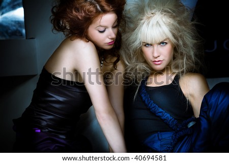 red hair and blond fashion models portrait, indoor shot - stock photo