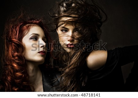 red hair and brunette woman portrait, studio shot
