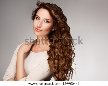Red Hair. Beautiful Woman with Curly Long Hair. High quality image. - stock photo