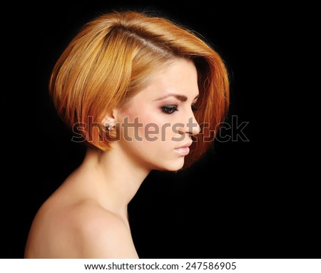 Red hair. Beautiful Woman with Short Hair on a black background. - stock photo