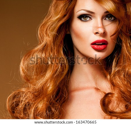 Red Hair. Fashion Girl Portrait. long  Hair and red lipstick. - stock photo