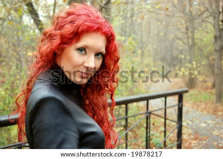 red hair gothic style woman over autumn background