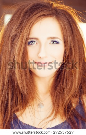 Red Hair Woman. Happy Fashion Model with Red Hairstyle and Blue Eyelashes - stock photo