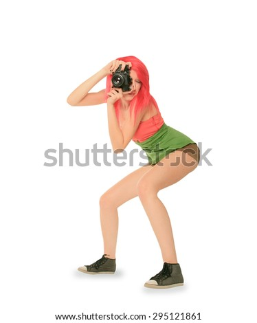 Red hair woman with photo camera isolated over white