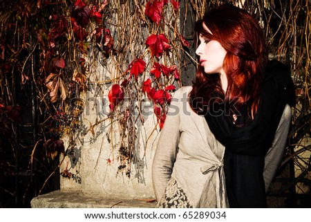 red hair young woman in sunny autumn afternoon outdoor shot - stock photo