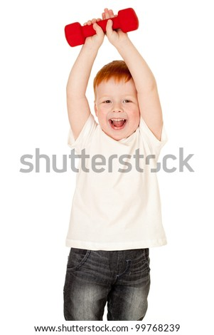 Red-haired adorable boy making exercise with dump-bells isolated - stock photo