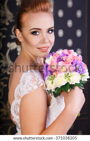 Red-haired beautiful bride with flowers  - stock photo