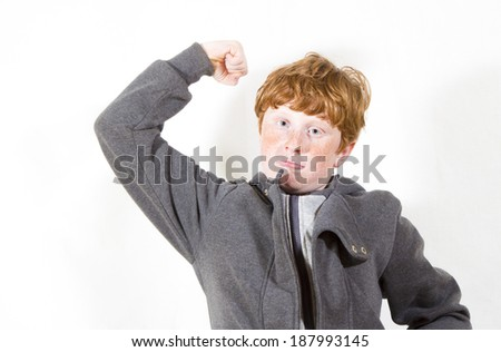 red-haired boy posing in studio  studio shooting