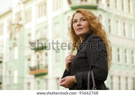 red-haired business woman leader outside - stock photo