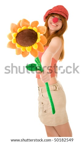Red haired clown girl with flower - stock photo