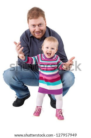 Red haired  father and his small daughter, who holds his hand, isolated on white