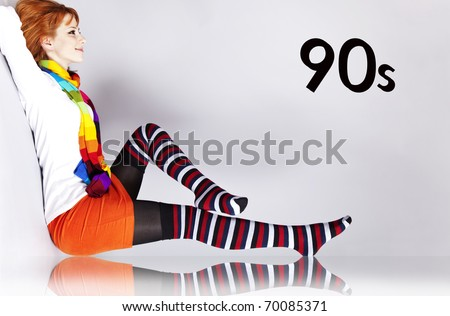 Red-haired girl in 90s colour style. With 90s number. - stock photo
