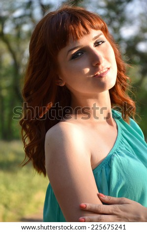Red-haired girl in the sun