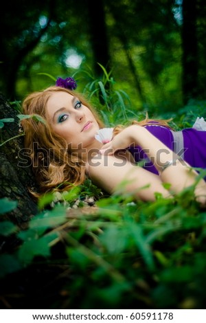 red-haired girl in wood - stock photo