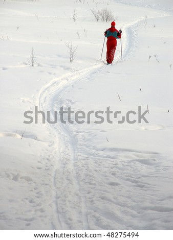 red-haired girl on the cross-country skiing - stock photo