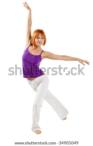Red haired girl performing fitness exercises on white background - stock photo