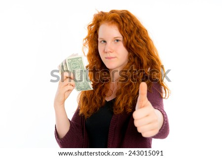 red haired girl with dollars and thumb up