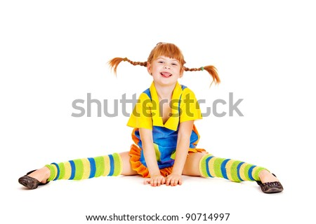Red haired girl with funny braids - stock photo