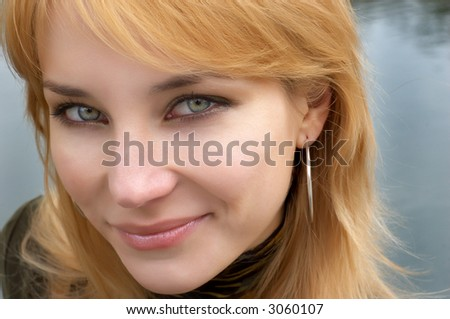 red haired girl with green eyes. soft portrait.
